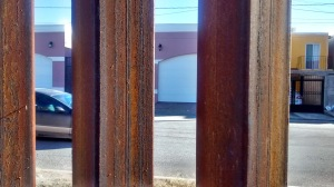 This is a close-up of the wall. Though here it is bars - some say as a fence, some say as a prison - in other places the wall is solid.